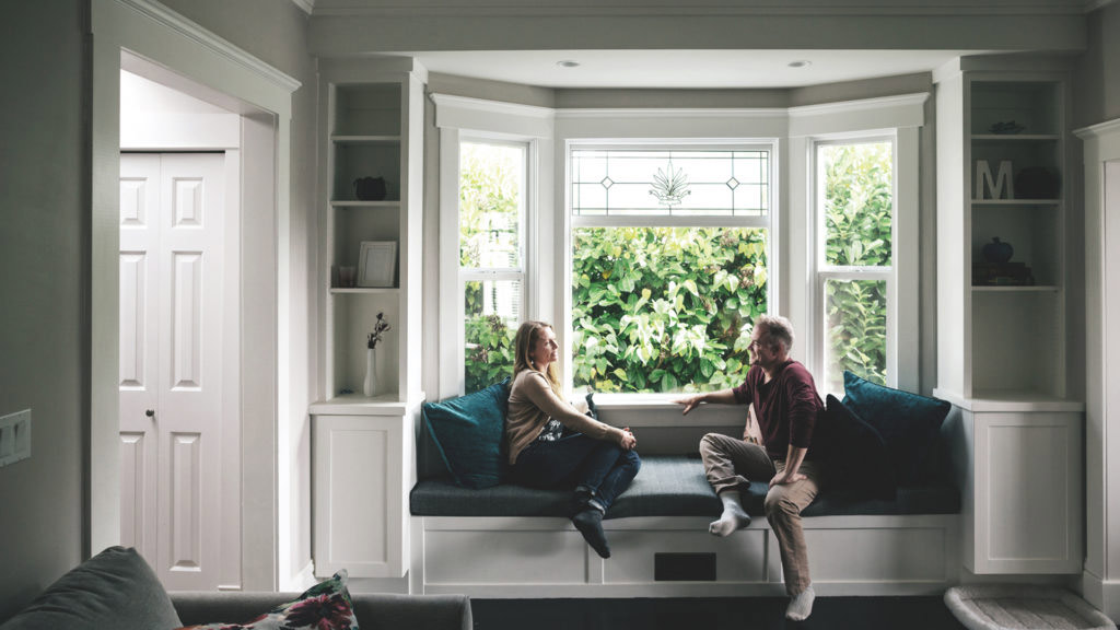 Selling Guide - couple talking at window seat